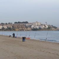 Rybáři na podzim na pláži